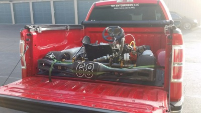go-kart transport in a red pickup truck