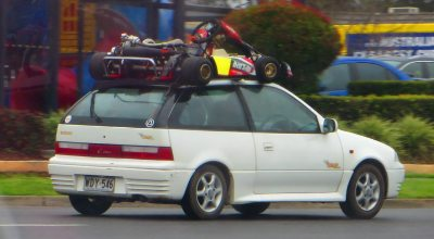 go-kart transport on top of a small car