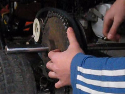 placing chain on go-kart