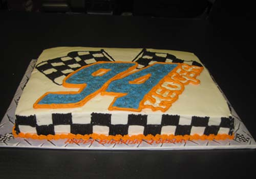 checkered flag go-kart cake