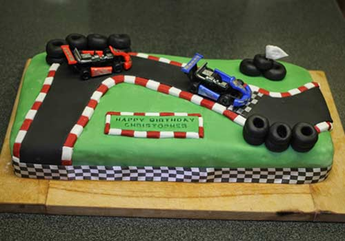 go-kart birthday cake with race tracks